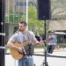 Brad Bosse performs outside of Penuche's. Courtesy photo.