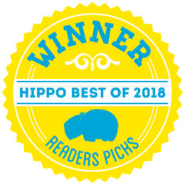A round graphic badge that reads Winner hippo best of 2020 Readers Pick, in the colors yellow and cyan