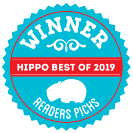 A round graphic badge that reads Winner hippo best of 2020 Readers Pick, in the colors cyan and red