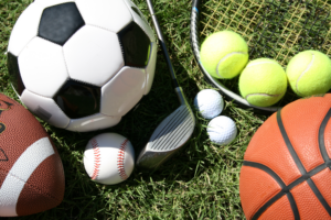 Photo of assorted sports equipment for football, soccer, tennis, golf, baseball, and basketball