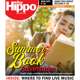 Hippo cover for June 25th 2020, has photo of pretty woman laying in grass and reading on a sunny day, a headline reads Summer Book Adventures