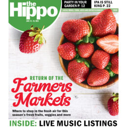 "Hippo Press cover for June 18th, 2020. headline is ""Return of the farmers market where to shop in the fresh air for this season's fresh fruits, veggies and more."" Photo of wooden bowl full of ripe strawberries on a distressed wooden background."