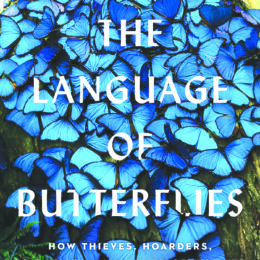 Cover of the book The Language of Butterflies by Wendy Williams. The cover has white font partially covered by a large group of blue butterflies.
