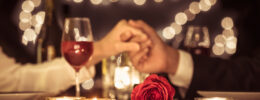 Romantic dinner date Wine glass rose candles