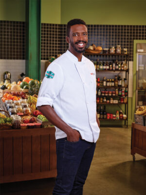 chef stands in grocery store