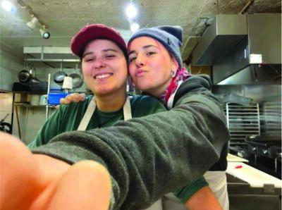 two chefs in kitchen selfie