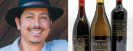 portrait of a man in a black hat, 3 wine bottles on white background
