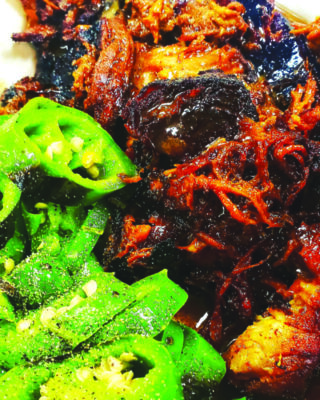 pulled pork dish with chopped jalapenos