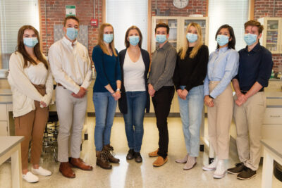 group standing wearing medical masks