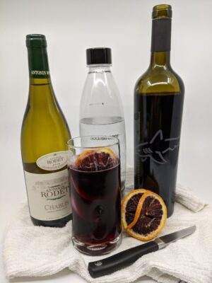 wine bottle and glass to make wine spritzers