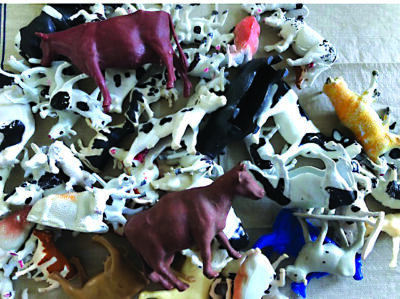 a pile of plastic cows