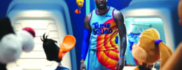 man in basketball uniform standing with cartoon characters