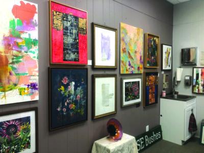 wall of framed artworks