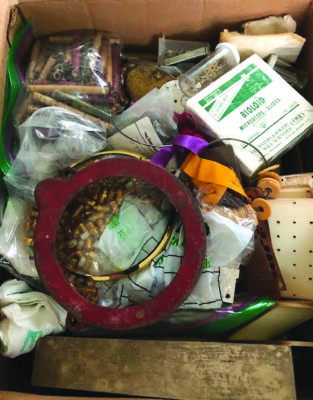 cardboard box of scraps of wire, metal, and bags of beads