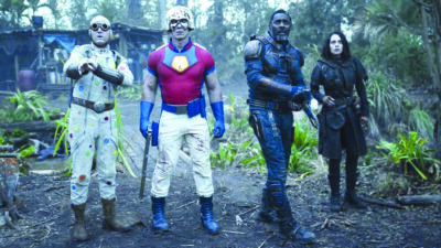 still from The Suicide Squad featuring the cast standing in a forest