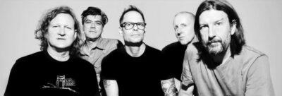 5 men posed together