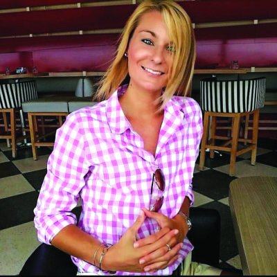 young woman smiling and posing in restauruant